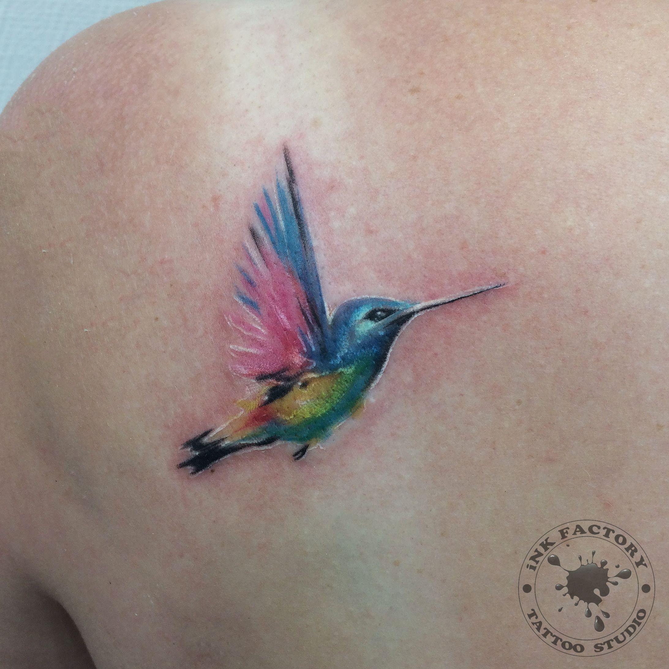 фото тату Татуировка птица феникс на лопатке 556