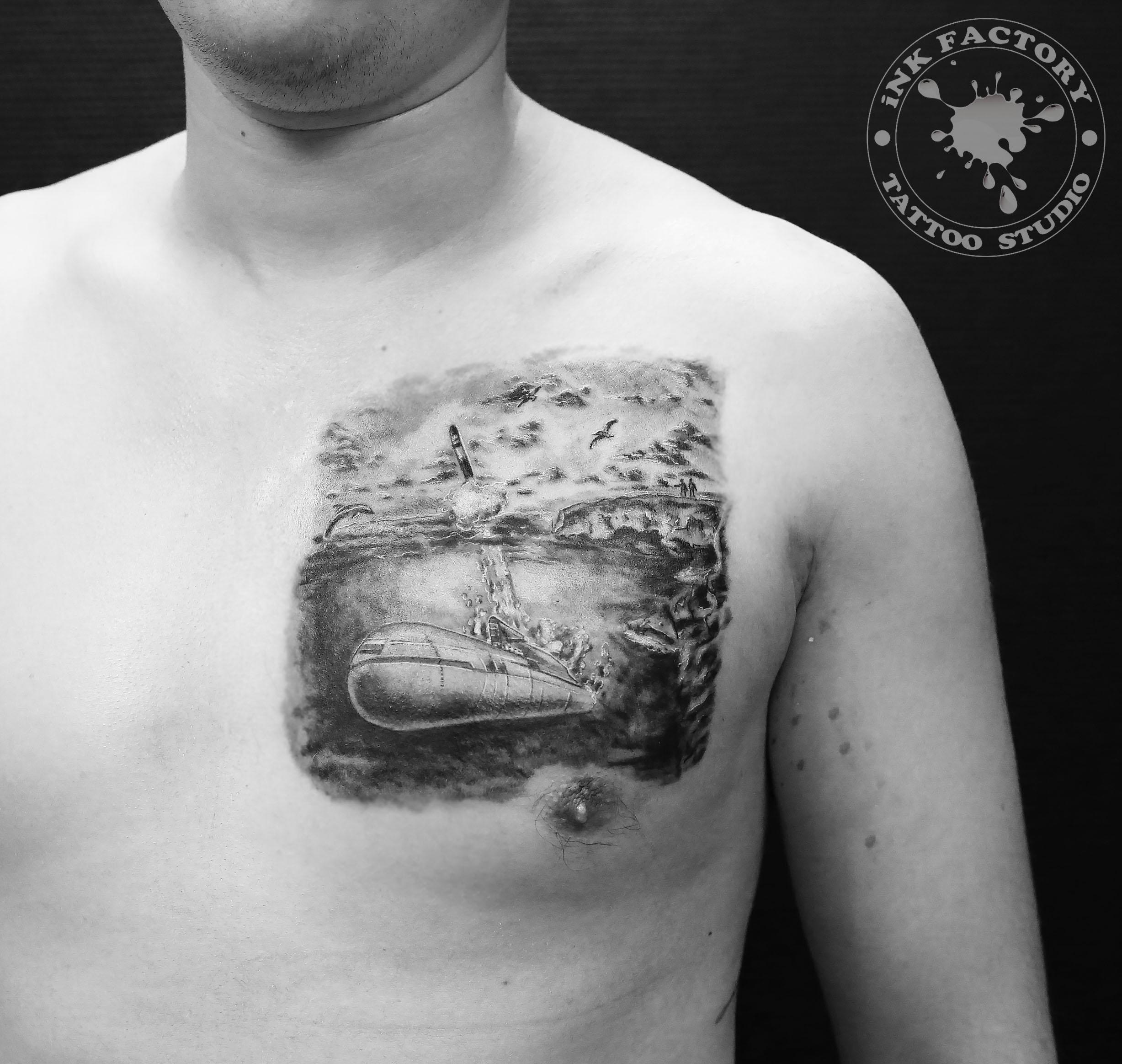 фото тату Татуировка печать на груди 470